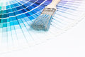 Open pantone sample colors catalogue paintbrushes and blue color samples over white background Stock Images