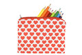 Open pencil case with heart pattern on a white bac Royalty Free Stock Photo