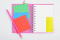 Open Purple Notebook with color post it and pencil Royalty Free Stock Photo