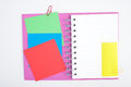 Open Purple Notebook with color post it on white background Royalty Free Stock Photo