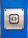 Open push button an switch on a blue door panel Royalty Free Stock Image