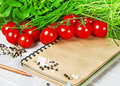 Open recipe book with vegetables healthy food tomatoes chives and spices Stock Images