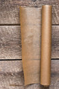 An open roll of paper on the wooden table background Royalty Free Stock Photo