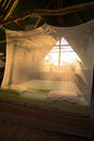 Open room in costa rica with mosquito net and orange light matapalo Stock Photos