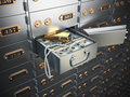 Open safe deposit box with money, jewels and golden ingot. Royalty Free Stock Photo