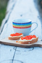 Open sandwich with red caviar dairy butter and and beverage Royalty Free Stock Photo