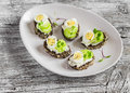Open sandwiches with cream cheese, quail eggs and celery. Delicious healthy Easter snack