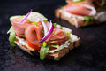 Open sandwiches with ham, tomato, cucumber and arugula Royalty Free Stock Photo