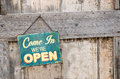 Open sign vintage on wooden door Stock Photography