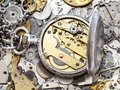 Open silver pocket watch on heap of spare parts Royalty Free Stock Photo