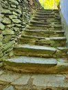 Open small steps at old building old worn out stony steps behind house stony wall from raw boulders and concrete Stock Photo