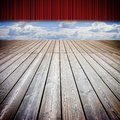 Open theater red curtains and wooden floor against a cloudy sky - concep timage Royalty Free Stock Photo