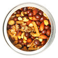 Open tin can of mixed nuts over white top view Stock Photo