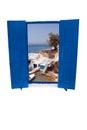 Open traditional Greek blue window on Mykonos island Royalty Free Stock Photo