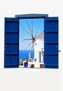Open traditional Greek blue window on Santorini island Royalty Free Stock Photo
