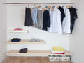 Open wardrobe with clothes Royalty Free Stock Photo