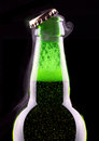 Open wet beer bottle isolated on black Royalty Free Stock Images