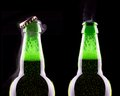 Open wet beer bottle isolated on black Royalty Free Stock Photography