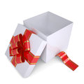 Open white gift box decorated with a red ribbon Royalty Free Stock Photo