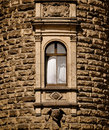 Open window in medieval tower flying white curtain historic building Royalty Free Stock Photography