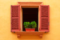 Open window on the yellow wall Royalty Free Stock Photo