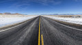 Open winter road a straight section of highway in nevada stretches on to the distant horizon in the Stock Photography