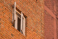 Open wood window in orange brick building Royalty Free Stock Photo