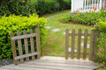 Open wooden gate and fence Royalty Free Stock Image