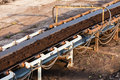 Opencast brown coal mine. Belt conveyor. Royalty Free Stock Photo