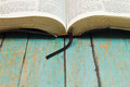 Opened Bible with a bookmark on Wood Royalty Free Stock Photo
