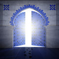 Opened blue doorway with radiance Royalty Free Stock Images