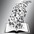 Opened book with flying letters alphabet Royalty Free Stock Image