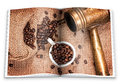 An opened  book with a picture Arabic copper turks, cup and  scattered coffee grains Royalty Free Stock Photo