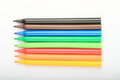Opened colorful pencils as rainbow on white background Royalty Free Stock Image