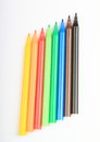 Opened colorful pencils as rainbow on white background Royalty Free Stock Images