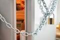 Opened door of locked fridge with chain and padlock Stock Image