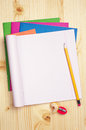 Opened exercise books and pencil on wooden table Royalty Free Stock Photography