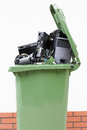 Opened garbage bin with electronics open on the white background Royalty Free Stock Photo