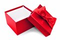 Opened gift box red with bow over a white background Stock Photography
