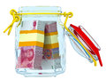 Opened glass jar with bundles of Chinese banknotes yuan
