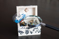 Opened jewelry box with ship in a bottle and magnifying glass Royalty Free Stock Image
