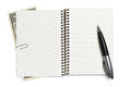 Opened notepad pen and dollar on white background Stock Photo