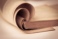 Opened old book in sepia and vintage color tone , selective focus Royalty Free Stock Photo