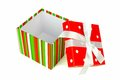 Red, green and white polka dot Christmas gift boxes stacked