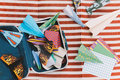 Opened Suitcase with Color Paper Planes on The White and Red Stripes Mat Royalty Free Stock Photo