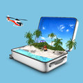 Opened suitcase that contains a paradise beach concept of with sea sand grass lounger helicopter Stock Images