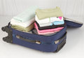 Opened suitcase packed lot colorful cloths Royalty Free Stock Image