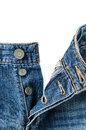 Opening blue jeans button crotch white background Stock Images