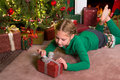 Opening christmas gifts Royalty Free Stock Photos