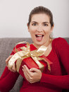 Opening a christmas present beautiful happy woman Stock Image